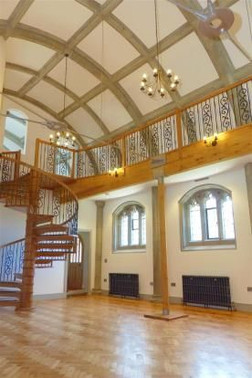 Completed Grade II listed Church conversion with spiral staircase and bridge to main livign area in Truro, Cornwall.