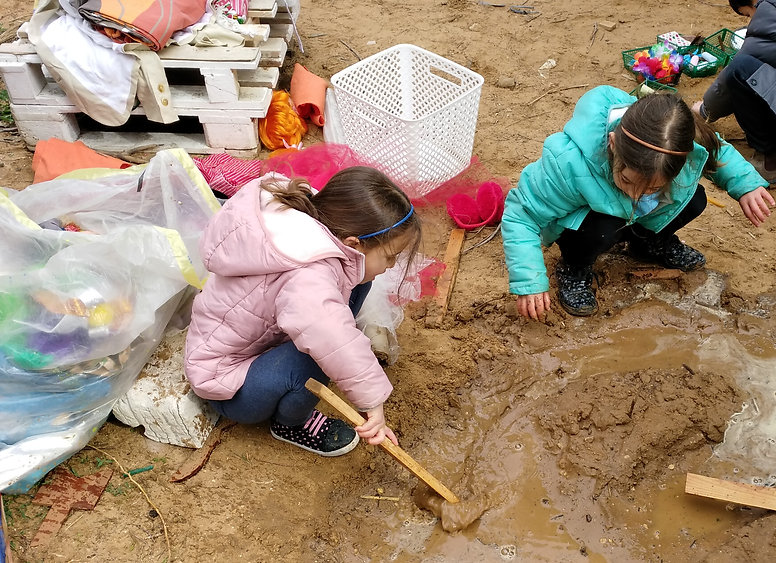 Digging in the sand with pieces of wood