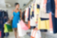 _-woman-leaves-clothes-shop-with-many-ba