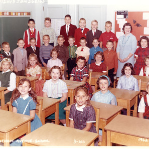 Third grade. Me in red and white sweater, top row, left