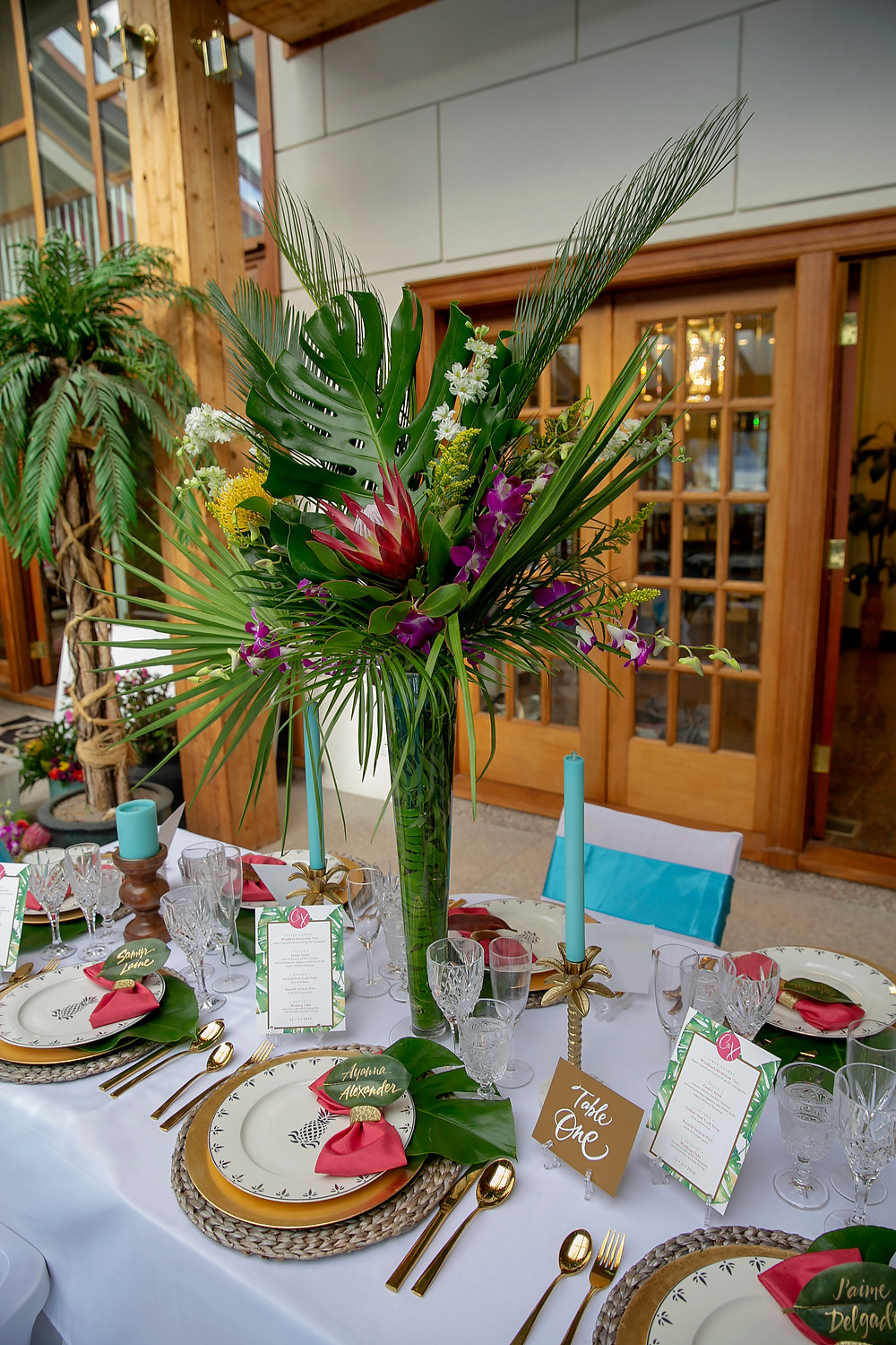 Wedding planner and designer tropical table decor. Photo by Vega Touch Studios.