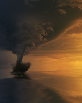 tornado-on-body-of-water-during-golden-h