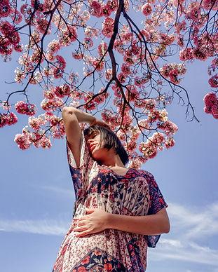 woman-standing-under-cherry-blossom-tree