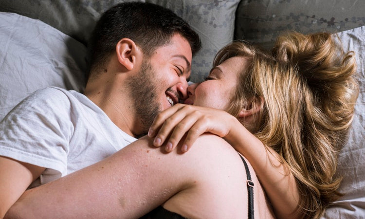 Man and woman happy in bed