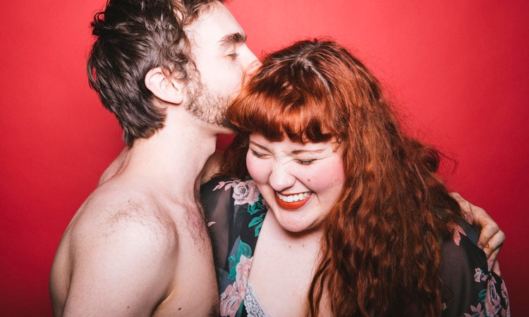 Topless man with Red Head Woman Embracing Red Background.