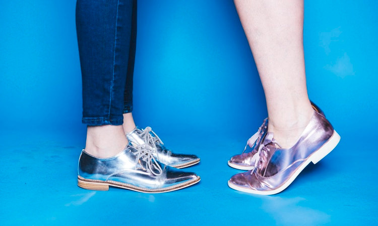 Knees down face-to-face shiny metallic shoes