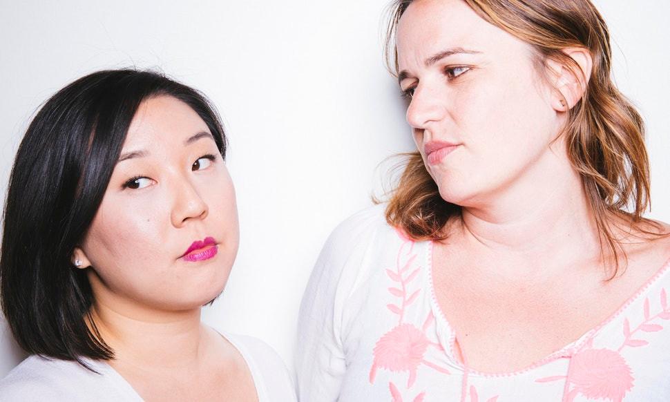 Asian woman white woman disagreement