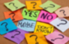 Colorful Post it notes withYes No Maybe Don't Know and Question Marks