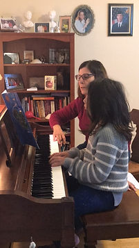 girl playing piano with beth.jpg