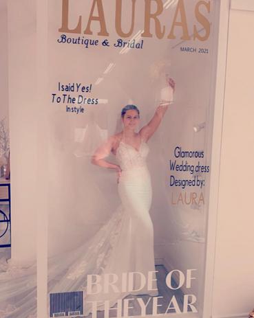 Bride inside Lauras Boutique Bridal Shop