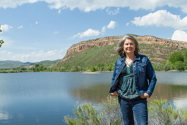 Jill MacKay standing by Watson Lake in Bellvue, Colorado.