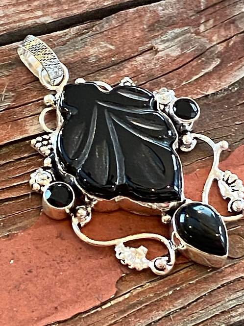 Carved Onyx Pendant