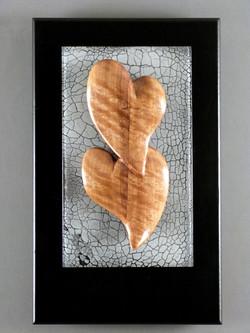 Curly Walnut Hearts/grey background.
