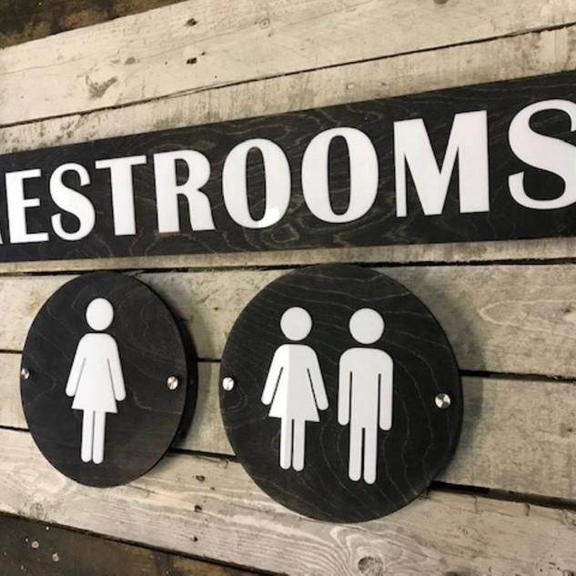 Custom Black Stain Restrooms Sign