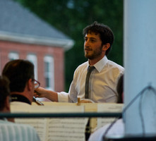 Conducting at an outdoor concert