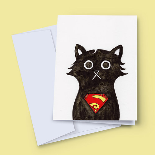 A 7x5 inch greeting card featuring an ink and salt black cat illustration wearing Superman's logo on his chest