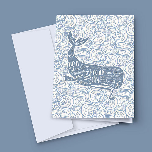 A 7x5 inch greeting card featuring a whale with wording over the top, surrounded by waves