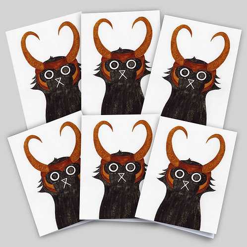 Greeting cards 6 pack featuring an ink and salt black cat illustration wearing Loki's helmet