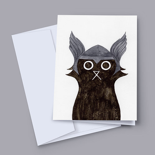 A 7x5 inch greeting card featuring an ink and salt black cat illustration wearing Thor's helmet