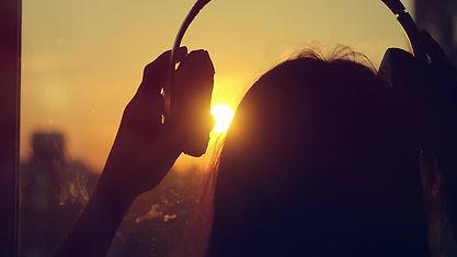 listening to music sunset.jpg