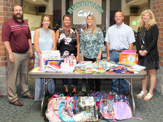 Taylor Communications donates school supplies