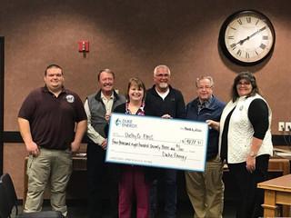 Duke Energy delivers grant award for Project Lifesaver program
