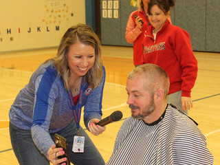 Southwestern principal rewards students with shaved head