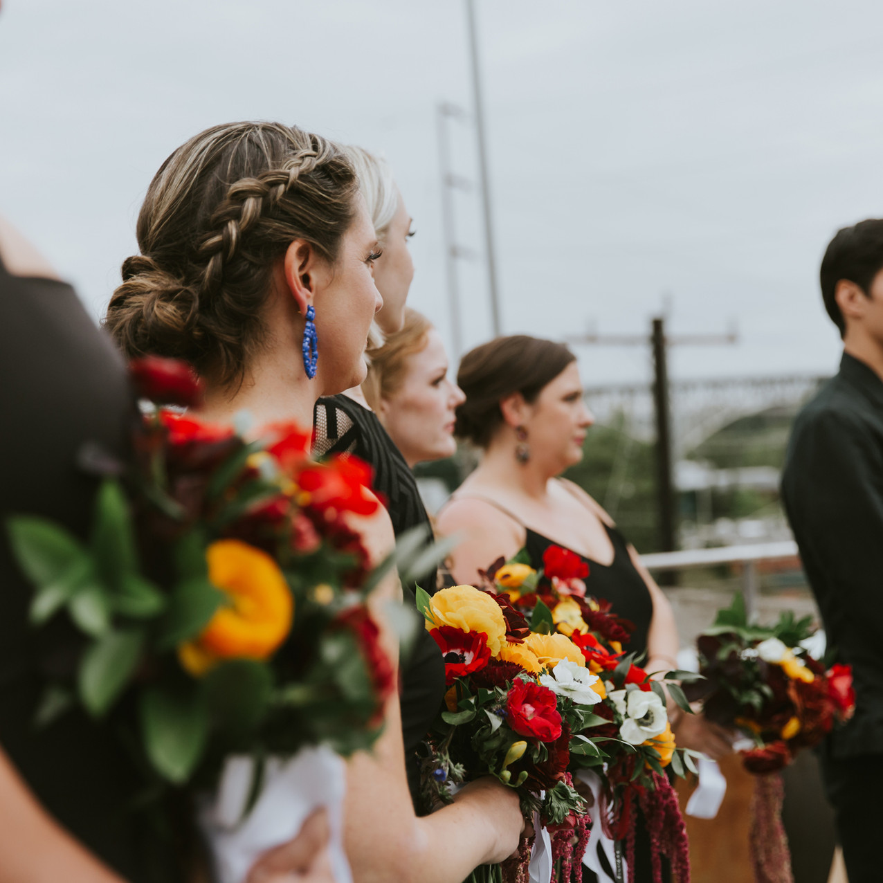 red yellow white and blue bridesmaid bou