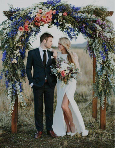 Floral Wedding Arch with Bride and Groom