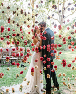 Red and White Floral Curtain with Bride and Groom