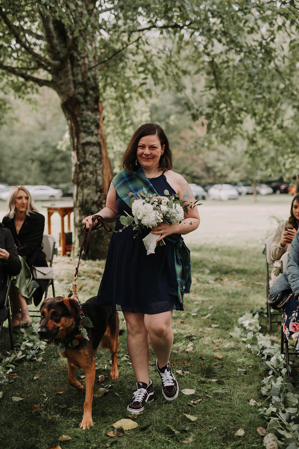 Bridesmaid with Dark Blue Dress and White Bouquet