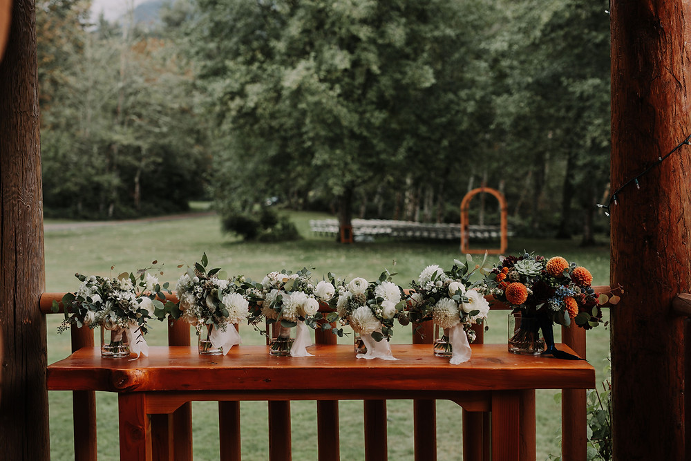 White Bridesmaid Bouquets with Colorful Bridal Bouquet