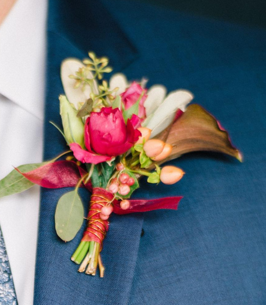 Pink white and green groom boutonniere