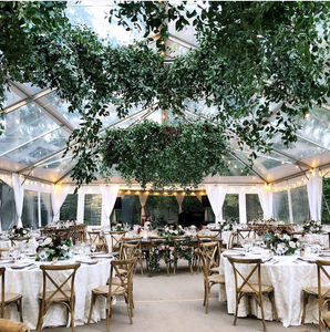 Greenery Hanging from Tent at Wedding Reception
