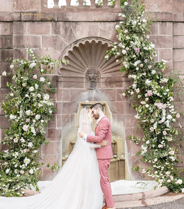Bride and Groom with Dramatic Floral Backdrop