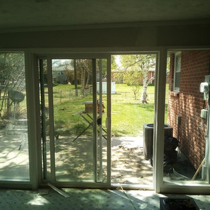 2 picture windows around a sliding door