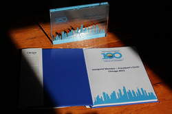 PC100 AWARD WITH OPEN CHICAGO BOOK