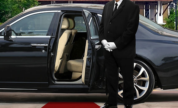 Limo driver standing next to opened car