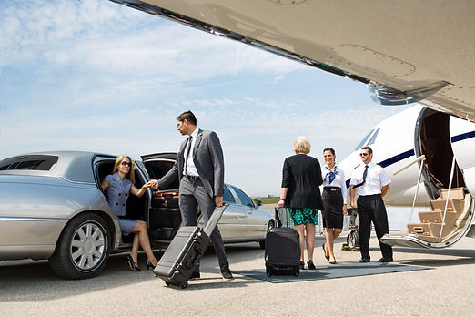 Business partners about to board private