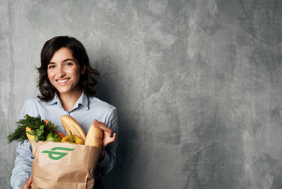 Smiling lady holding bag 2.jpg