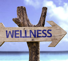 Wellness wooden sign with a beach on bac