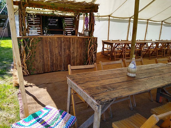 Rustic Mobile bar inside our Traditional Pole Marquee