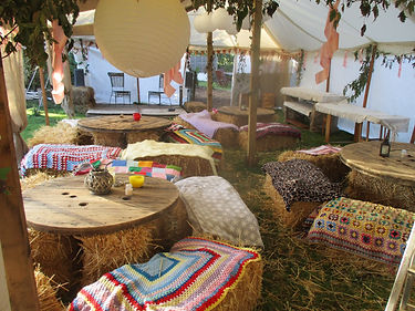 Inside Rustic Marquee with informal seating