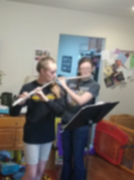 Bridge takes a flute lesson with Erin Spencer
