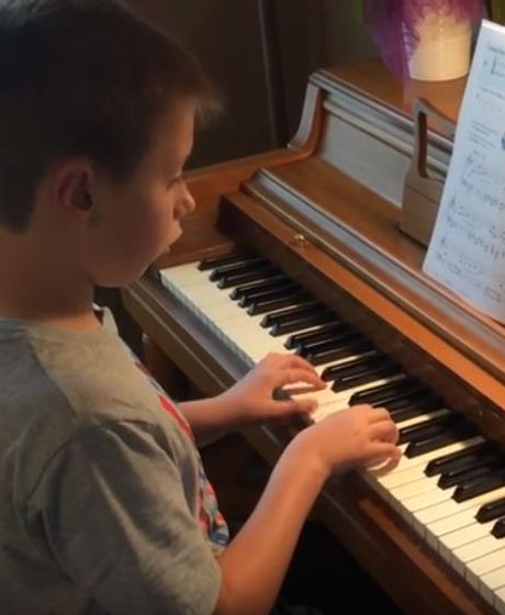 Harrison takes a piano lesson with Erin Spencer