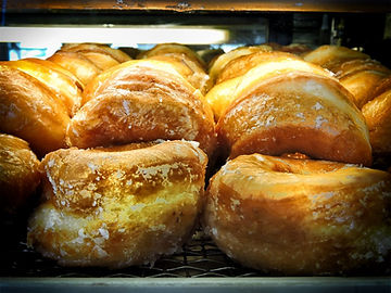 Baker's Pride's doughnuts come in glazed, covered, filled, or, even, in holes.