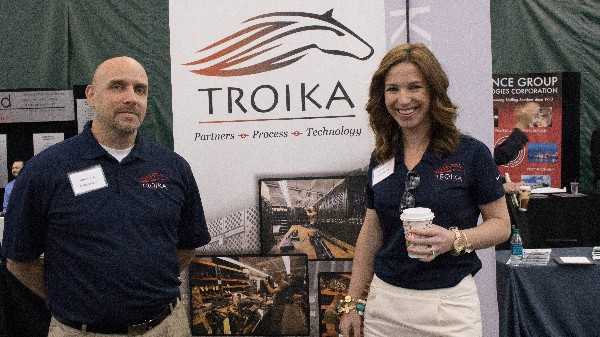 Matt Edwards and Jamie Medlock discussing Troika's Automated Armory and other technology solutions.