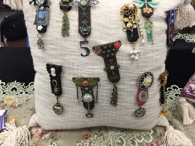Statement Brooches on Pillow