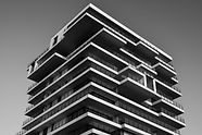 grayscale-photo-of-concrete-building-157
