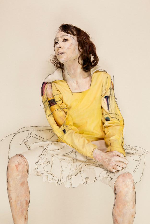 Sitting girl with raised head